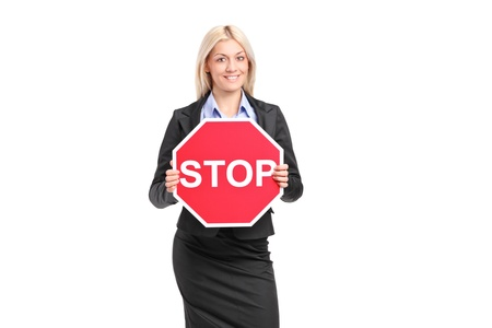 with stop sign: A businesswoman holding a traffic sign stop isolated on white background