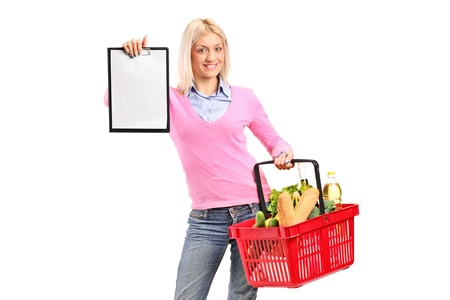 A female holding a shopping basket and showing a clipboard isolated on white background photo