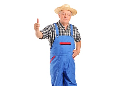 Mature smiling farmer giving a thumb up isolated on white background photo