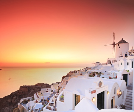 A view over a village on Santorini island, Greece at sunset photo