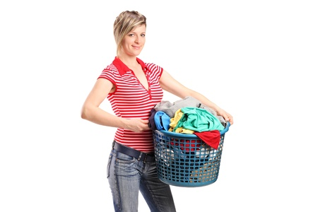 A young woman holding a laundry basket isolated against white background Stock Photo - 11958272