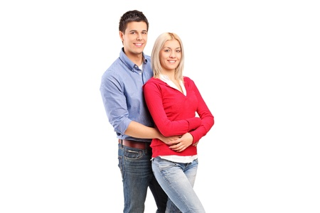 Young loving couple in an embrace isolated against white background Stock Photo - 11958238