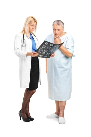 Senior man with his doctor, looking at the results of his CT scan isolated on white background photo
