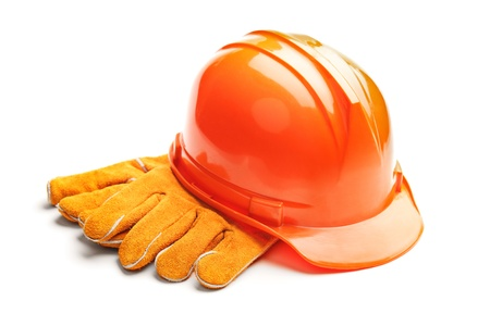A studio shot of a standard construction safety equipment, helmet and gloves, isolated on white background photo