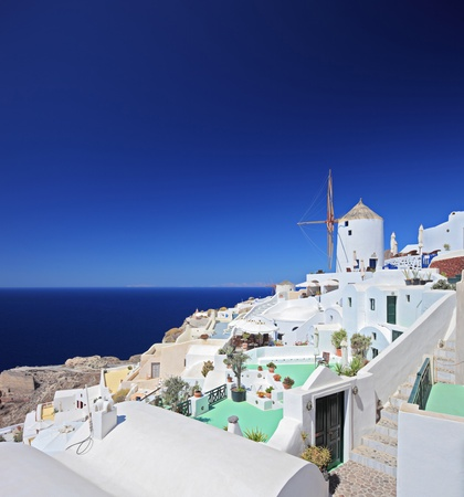 A view over a village on Santorini island in Greece photo