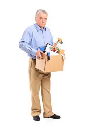 unemployed dismissed: Full length portrait of a fired man carrying a box of personal items isolated on white background
