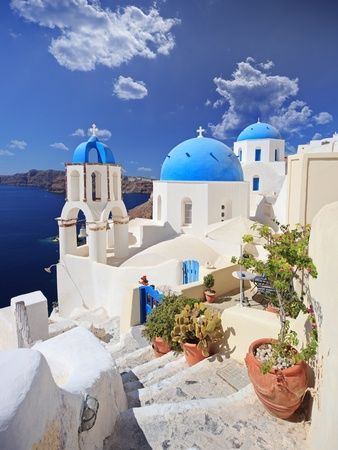 View of blue dome church in Oia village on Santorini island, Greece photo