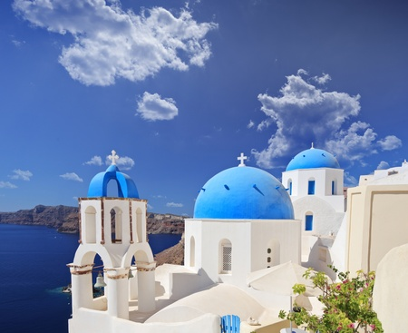 Blue domed church in Oia village on Santorini island, Greece photo