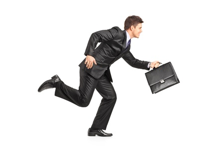 leaving: Businessman running with a briefcase isolated on white background