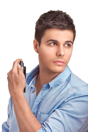 fragrance: A handsome young man using perfume isolated on white background Stock Photo