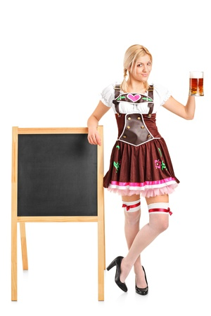 Full length portrait of a woman wearing traditional costume and holding a beer glass isolated on white background  photo