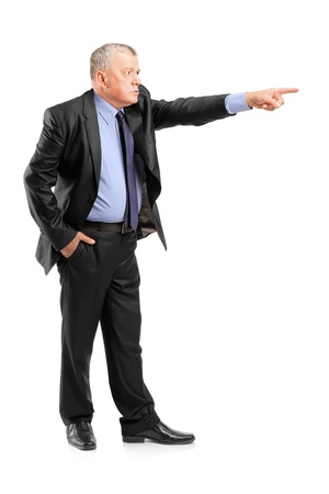 angry boss: Full length portrait of an angry boss firing an employee isolated on white background