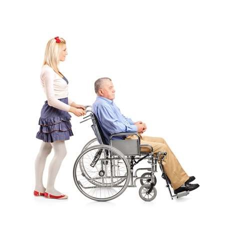 paraplegia: Full length portrait of a daughter pushing her dad in a wheelchair isolated on white background