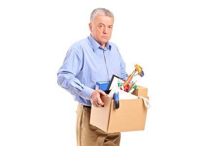 slump: Fired man carrying a box of personal items isolated on white background Stock Photo