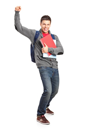Full length portrait of a happy student holding books isolated on white background Stock Photo - 12633749