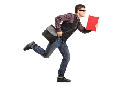 to rush: Full length portrait of a student in rush running with notebook isolated on white background Stock Photo