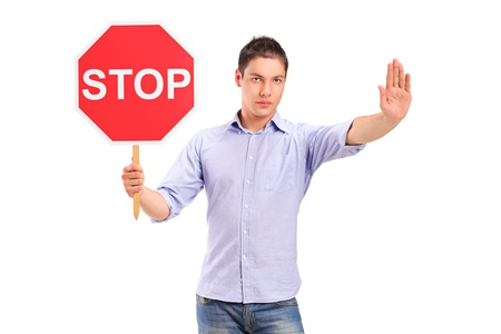 A man gesturing and holding a traffic sign stop isolated against white background photo