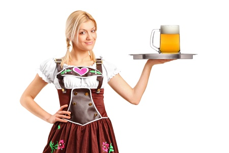 german alcohol: A woman wearing traditional costume and holding a tray with beer glass isolated on white background Stock Photo