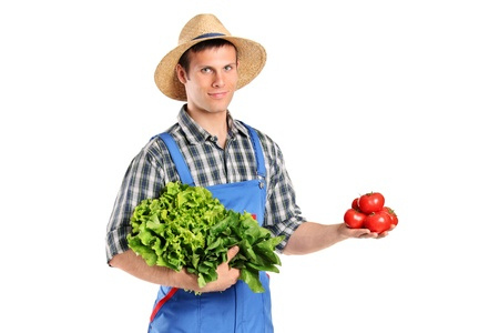A male farmer holding vegetables isolated on white background photo