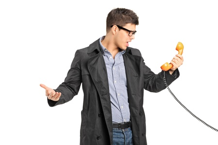retro phone: A surprised male holding a telephone tube isolated on white background