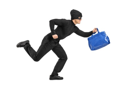 fugitive: Full length portrait of a thief running with a stolen purse isolated on white background