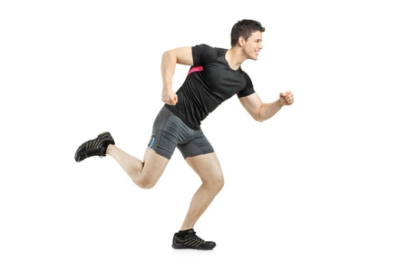 Full length portrait of an athlete running isolated on white background