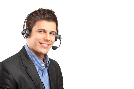 telephonist: Portrait of a handsome customer service operator wearing a headset isolated on white background