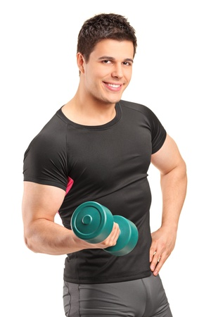 A smiling bodybuilder lifting up a dumbbell isolated on white background photo