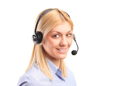 Portrait of a smiling female customer service operator wearing a headset isolated against white background photo