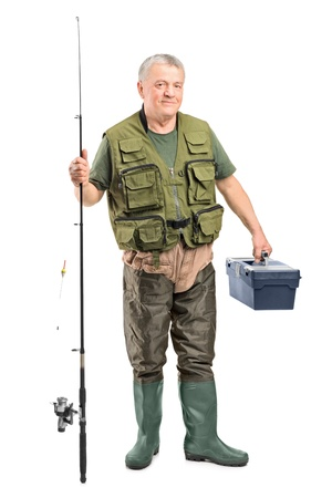 waders: Full length portrait of a mature fisherman holding a fishing equipment isolated on white background Stock Photo