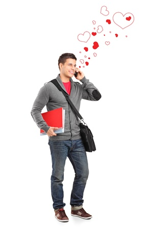students talking: Full length portrait of a smiling boy holding books and talking for love isolated on white background