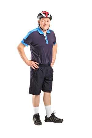 Full length portrait of a senior athlete wearing helmet isolated on white background  photo