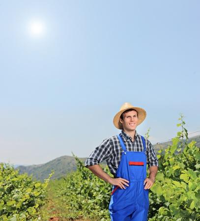 Male vintner posing at vineyard, Macedonia photo