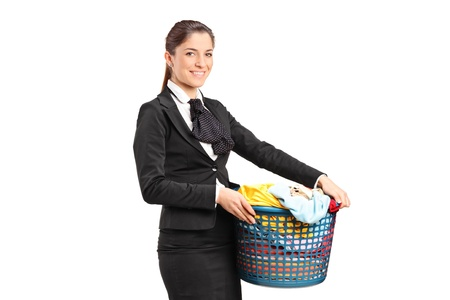 A female in a suit holding a laundry basket isolated on white background photo