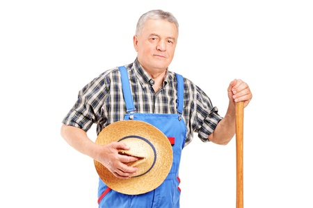 A mature farmer posing isolated on white background Stock Photo - 12633896