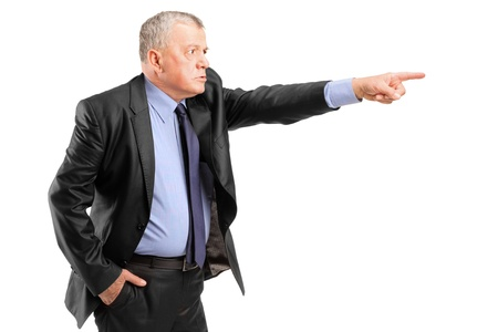 displeased businessman: An angry boss firing an employee isolated on white background