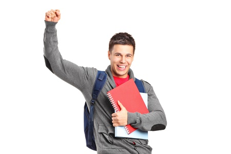 A happy student holding books and gesturing isolated on white background photo