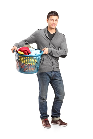 household tasks: Full length portrait of a man holding a laundry basket isolated on white background