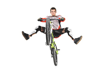 A young biker with his bike jumping isolated on white background photo