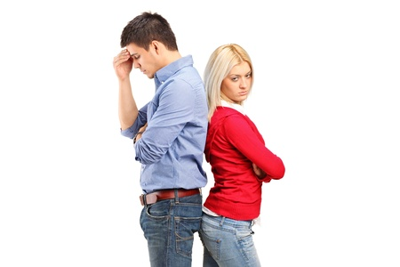 Couple with their backs turned after having an argument isolated against white background Stock Photo - 12883300