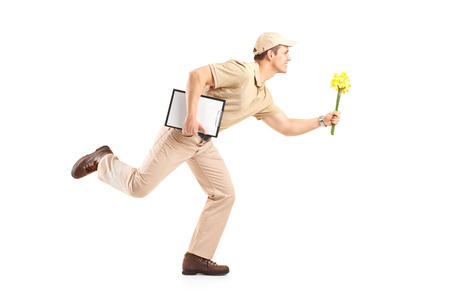 Delivery boy in a rush delivering flowers isolated on white background photo