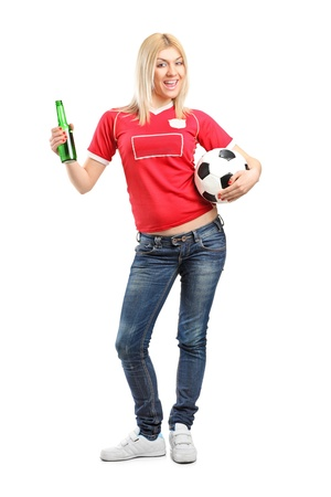 Full length portrait a blond female fan holding a beer bottle and football isolated on white background photo
