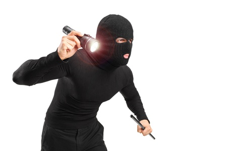 robberies: A robber with robbery mask holding a flashlight and piece of pipe isolated on white background