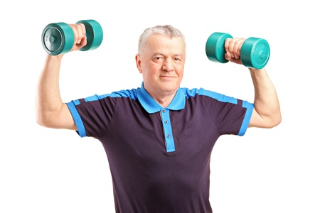 A mature man lifting up a dumbbells isolated on white background photo