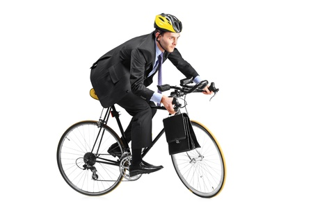 A young businessman riding a bicycle going towards his workplace isolated on white background photo