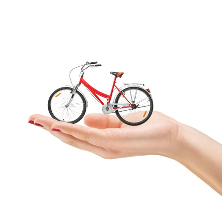 bike wheel: Beautiful manicured female hand holding a bike isolated on white background