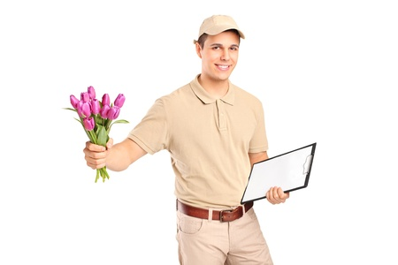 bouqet: Delivery boy holding a clipboard and bunch of flowers isolated on white background Stock Photo