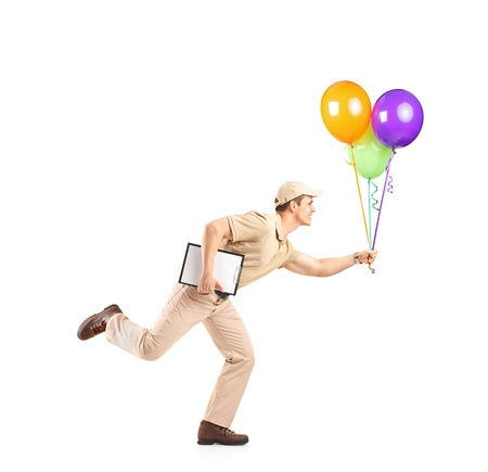 Delivery boy in a rush delivering balloons isolated on white background photo