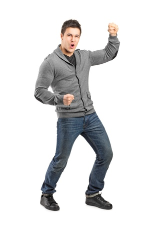 Full length portrait of a male gesturing happiness isolated on white background photo