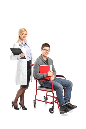 Full length portrait of a healthcare practitoner pushing a man in wheelchair isolated against white background photo